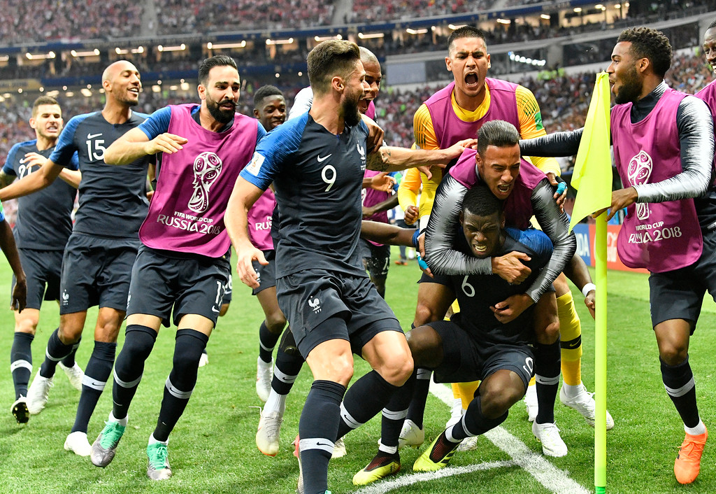 . France\'s Paul Pogba, third from right, celebrates with his teammates after scoring his side\'s third goal during the final match between France and Croatia at the 2018 soccer World Cup in the Luzhniki Stadium in Moscow, Russia, Sunday, July 15, 2018. (AP Photo/Martin Meissner)
