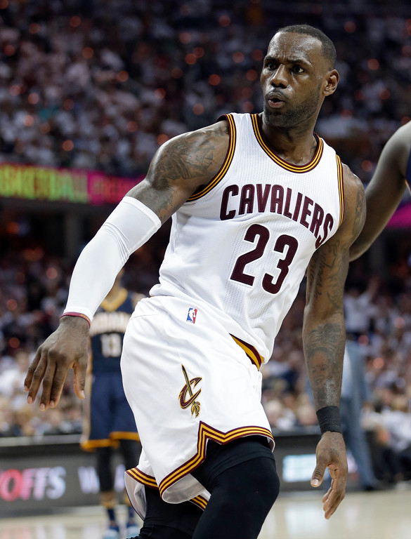 . Cleveland Cavaliers\' LeBron James reacts after scoring in the first half in Game 1 of a first-round NBA basketball playoff series against the Indiana Pacers, Saturday, April 15, 2017, in Cleveland. (AP Photo/Tony Dejak)