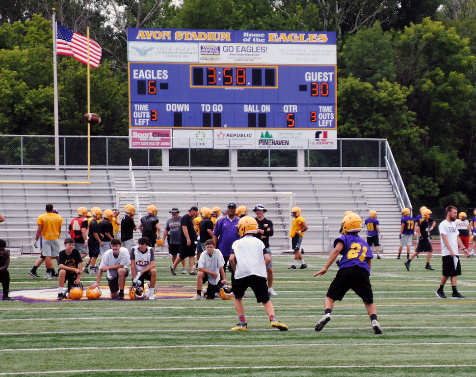 . Jon Behm - The Morning Journal<br> The Eagles practiced with the scoreboard reading a 30-6 Avon loss during Avon\'s first day of football practice on July 30. The score was reflective of the state semifinal loss to Akron Hoban last year.