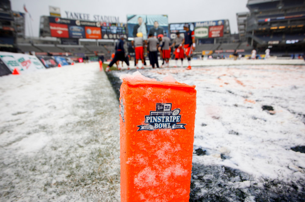 Description of . Snow covers a goal marker before the New Era Pinstripe Bowl between West Virginia Mountaineers and the Syracuse Orange at Yankee Stadium on December 29, 2012 in the Bronx borough of New York City.  (Photo by Jeff Zelevansky/Getty Images)