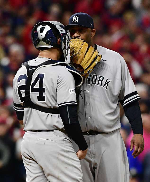 . New York Yankees starting pitcher CC Sabathia, right, talks with catcher Gary Sanchez during the fifth inning of Game 5 of the team\'s baseball American League Division Series against the Cleveland Indians, Wednesday, Oct. 11, 2017, in Cleveland. (AP Photo/David Dermer)