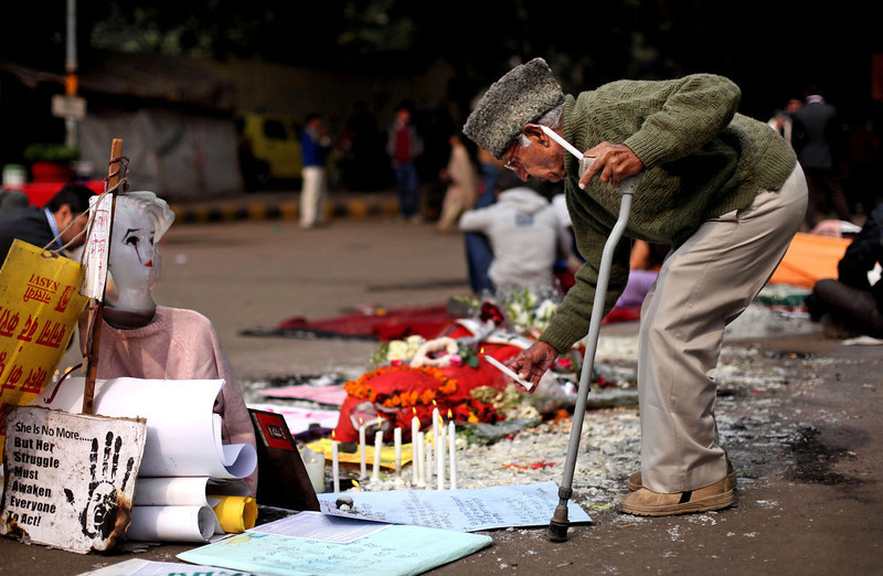 . An elderly Indian man lights a candle at a makeshift memorial of a gang-rape victim in New Delhi, India, Thursday, Jan. 3, 2013. Indian police were preparing Thursday to file rape and murder charges against a group of men accused of sexually assaulting the 23-year-old university student for hours on a moving bus in New Delhi. The Dec. 16 attack on the woman, who later died of her injuries, has caused outrage across India, sparking protests and demands for tough new rape laws, better police protection for women and a sustained campaign to change society\'s views about women. (AP Photo/Altaf Qadri)