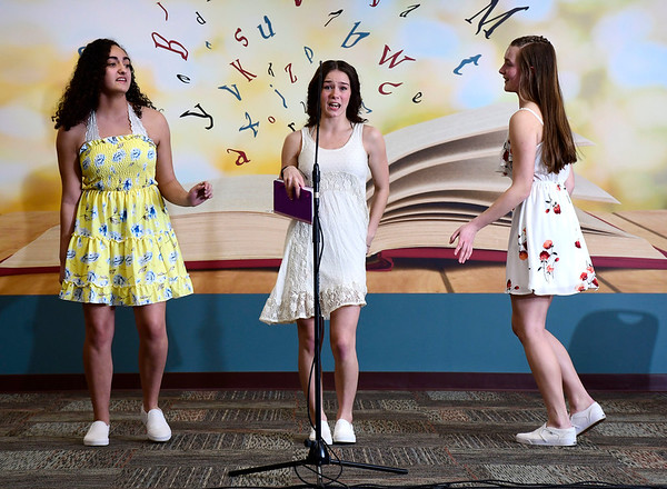 3/4/2020 Mike Orazzi | Staff New Britain High School Students Abby Olsen, Sara Colapietro and Isabella Petrisko during a performance of Mamma Mia! at the New Britain Public Library on Wednesday night. The full show will be performed at New Britain High School on March 20 & 21st.