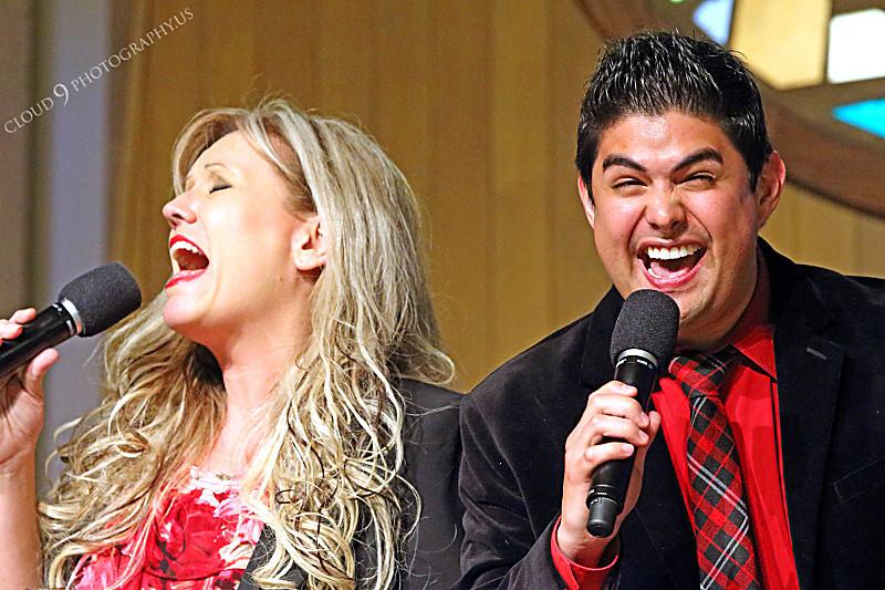 AMER-CMM 00036 Heritage Singers Lisa Jensen and Miguel Verazas sing before a church audience by Peter J Mancus.JPG