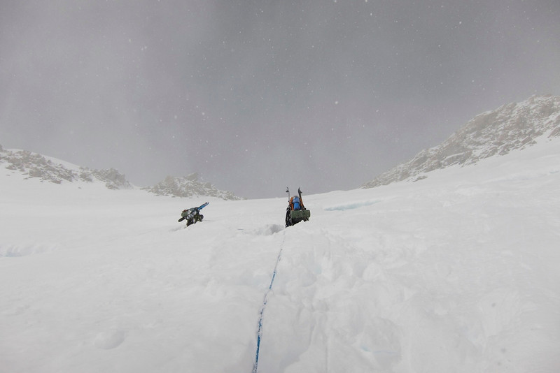 """July 4th (Day #12) - snowy day. About noon we decided to go up. From left: Durny and me looking (digging) for the fixed ropes by """"swimming"""" in the fresh snow. More than 1/2m of new snow. We survived one avalanche."""