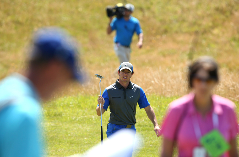 . Northern Ireland\'s Rory McIlroy walks to the 13th green during his first round on the opening day of the 2014 British Open Golf Championship at Royal Liverpool Golf Course in Hoylake, north west England on July 17, 2014. Rory McIlroy went to five under after just 12 holes to share the lead in the first round of the British Open at Royal Liverpool Golf club on Thursday. (ANDREW YATES/AFP/Getty Images)