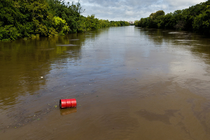 Barrel and other debris in Passaic River.