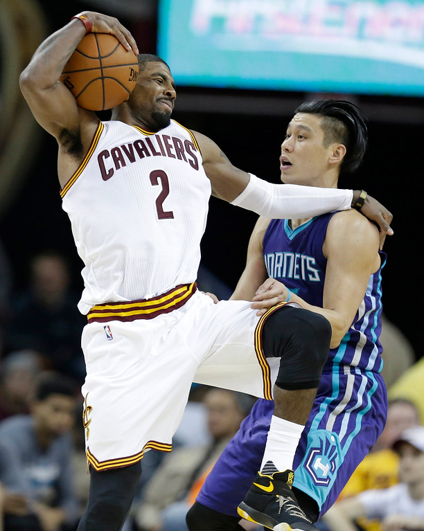 . Cleveland Cavaliers\' Kyrie Irving, left, catches a pass against Charlotte Hornets\' Jeremy Lin in the second half of an NBA basketball game Wednesday, Feb. 24, 2016, in Cleveland. The Cavaliers won 114-103. (AP Photo/Tony Dejak)