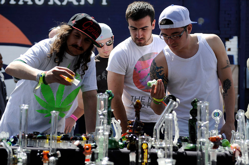 . Customers look over glass pipes and bongs made by the Rambler at a booth during the final day of the first ever High Times US Cannabis Cup at the Exdo Center in Denver on Sunday, April 21, 2013. Seth A. McConnell, The Denver Post