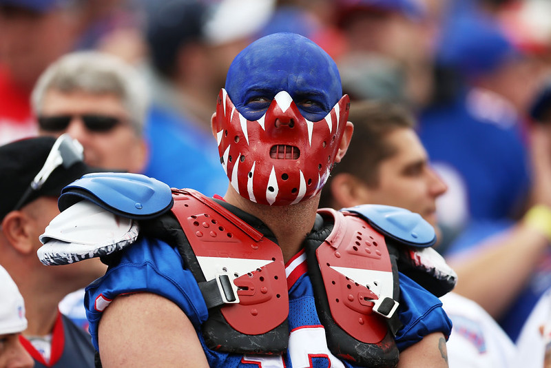. A fan of the Buffalo Bills sits in the stands during the first half against the Miami Dolphins at Ralph Wilson Stadium on September 14, 2014 in Orchard Park, New York.  (Photo by Vaughn Ridley/Getty Images)