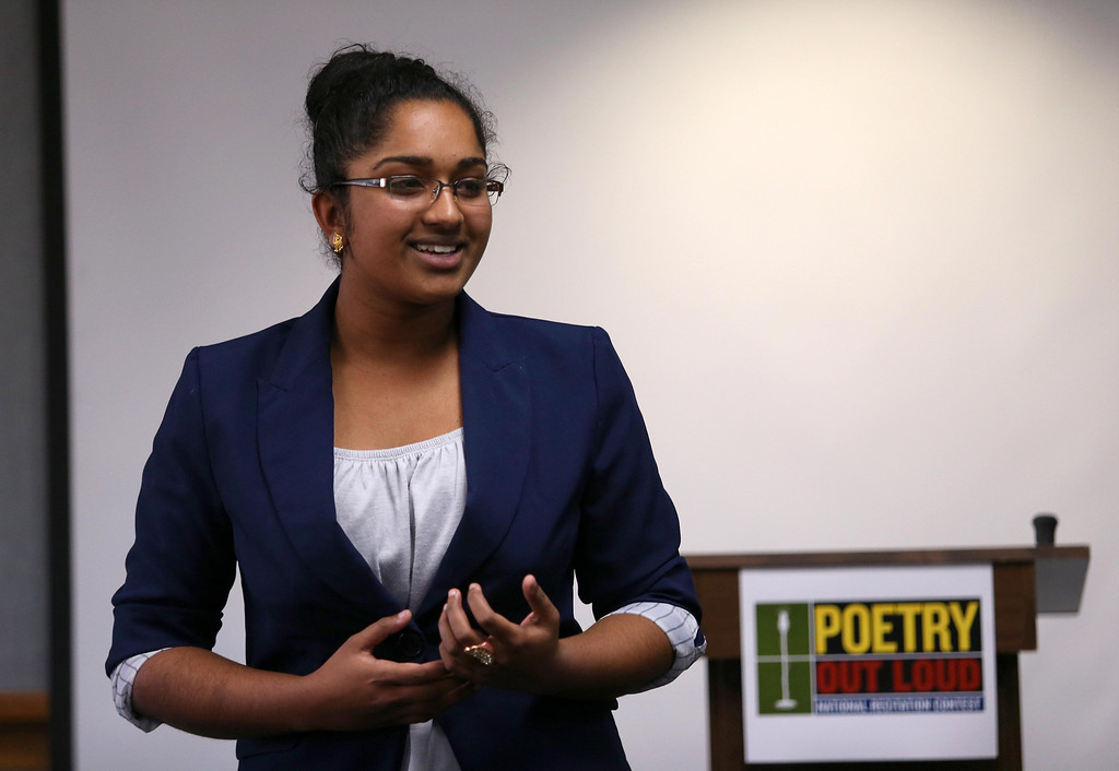 """. Sharanya Stanley, of Dublin High School, reads \""""My Brother, The Artist, at Seven,\"""" by Philip Levine, during the Poetry Out Loud competition at the Alameda County Lakeside Plaza Building in Oakland, Calif., on Wednesday, Feb. 13, 2013.  (Jane Tyska/Staff)"""