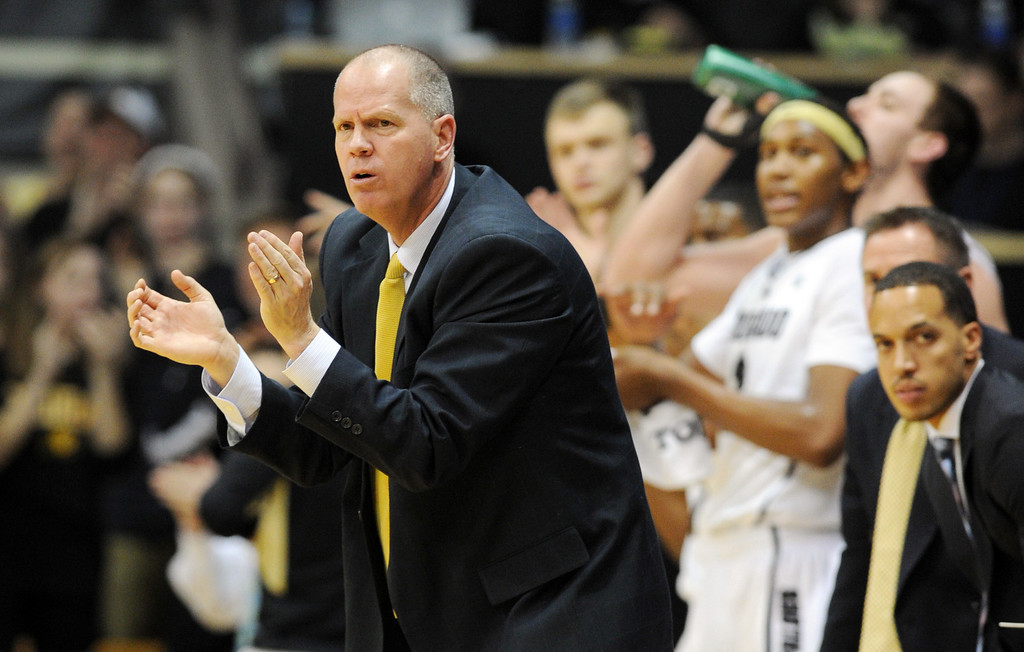 . Coach Tad Boyle of Colorado encourages his team during the first half of the February 16th, 2013 game in Boulder. Cliff Grassmick / February 16, 2013