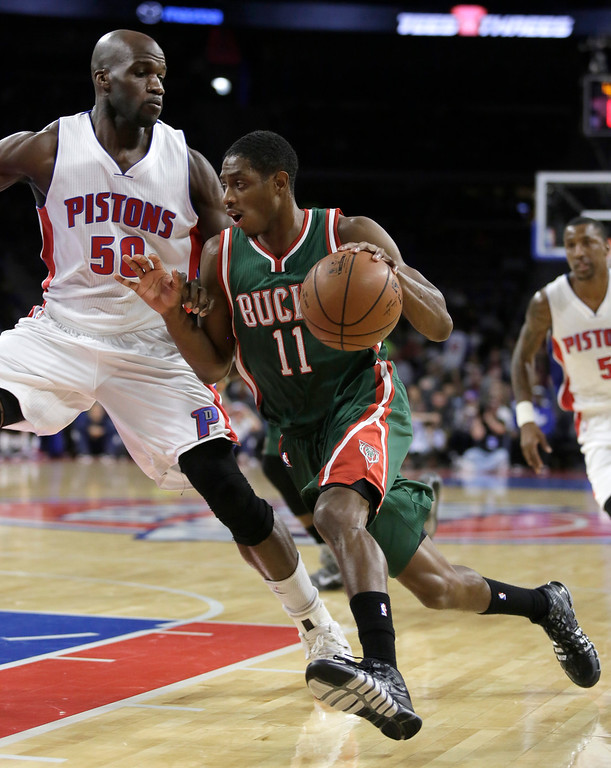 . Milwaukee Bucks\' Brandon Knight (11) drives to the basket against Detroit Pistons\' Joel Anthony (50) during the first half of an NBA basketball game Friday, Nov. 7, 2014, in Auburn Hills, Mich. (AP Photo/Duane Burleson)