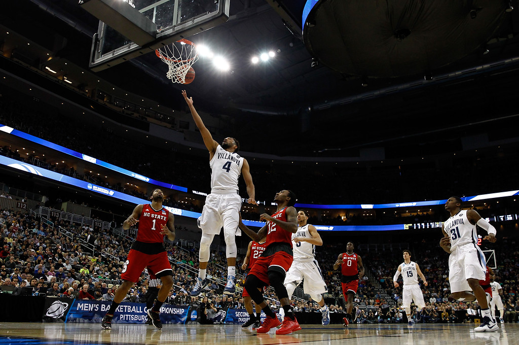 . Darrun Hilliard II #4 of the Villanova Wildcats puts up a shot against the North Carolina State Wolfpack in the first half during the third round of the 2015 NCAA Men\'s Basketball Tournament at Consol Energy Center on March 21, 2015 in Pittsburgh, Pennsylvania.  (Photo by Jared Wickerham/Getty Images)