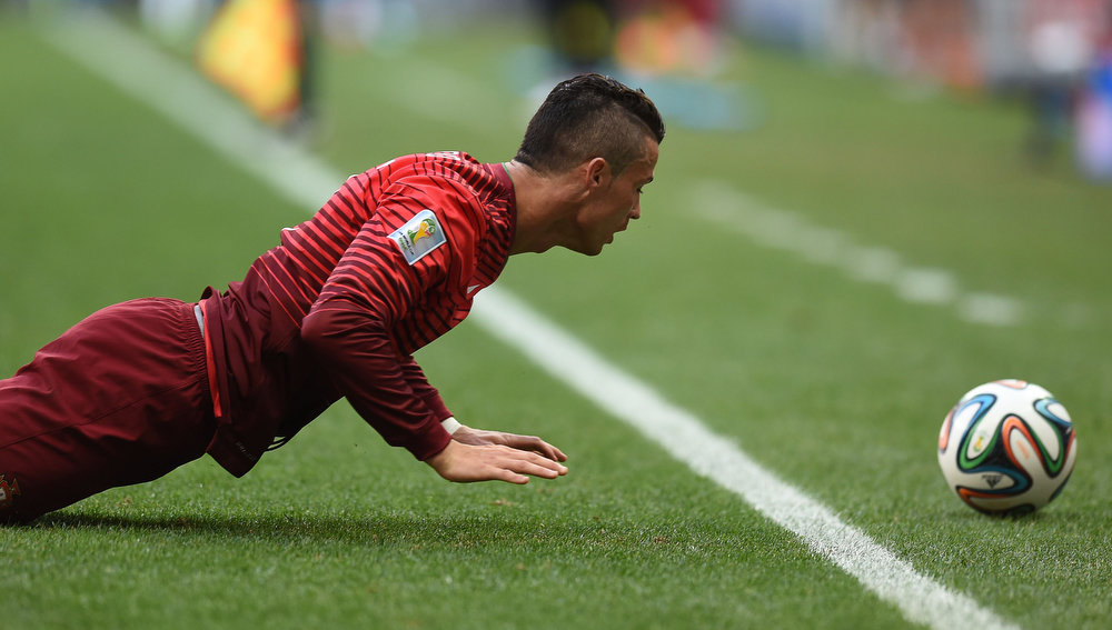 . Portugal\'s forward and captain Cristiano Ronaldo pushes himself up off the ground during the Group G football match between Portugal and Ghana at the Mane Garrincha National Stadium in Brasilia during the 2014 FIFA World Cup on June 26, 2014. (CARL DE SOUZA/AFP/Getty Images)