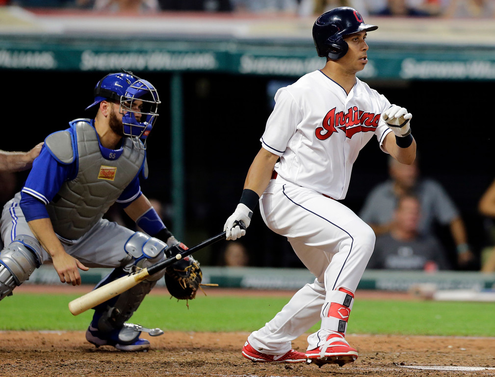 . Cleveland Indians\' Michael Brantley watches his grounder off Toronto Blue Jays starting pitcher Marco Estrada during the fifth inning of a baseball game, Friday, July 21, 2017, in Cleveland. Brantley was safe at first base, Francisco Lindor was out at second, and Roberto Perez scored. Blue Jays catcher Russell Martin watches. (AP Photo/Tony Dejak)