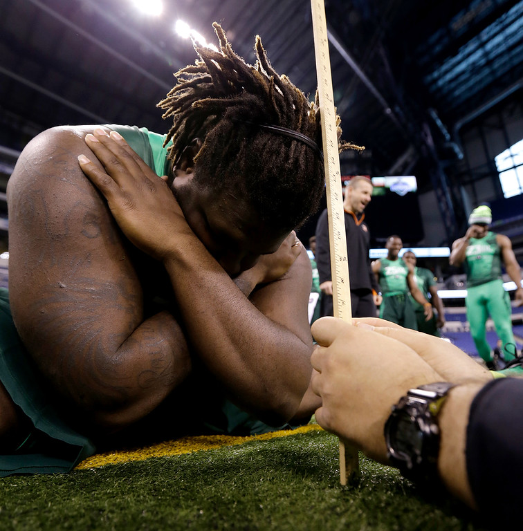 . Texas defensive lineman Malcom Brown is measured at the NFL football scouting combine in Indianapolis, Sunday, Feb. 22, 2015. (AP Photo/Julio Cortez)