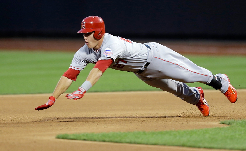 . American League\'s Mike Trout, of the Los Angeles Angels, dives safely to second base for a double during the first inning of the MLB All-Star baseball game, on Tuesday, July 16, 2013, in New York. (AP Photo/Kathy Willens)