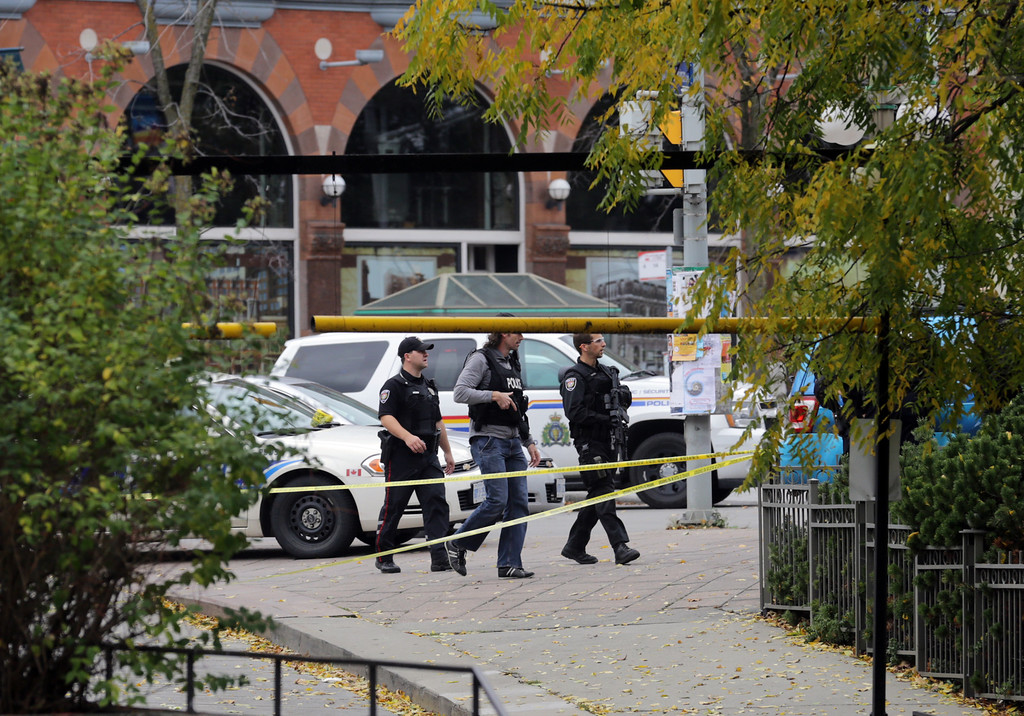 . Ottawa police patrol along Elgin St. steps away from the National War Memorial where a soldier was shot this morning, October 22, 2014 in Ottawa, Canada. Officials are investigating multiple reports of shootings and suspects after at least one gunman shot a Canadian soldier and then entered Canada\'s Parliament building.   (Photo by Mike Carroccetto/Getty Images)