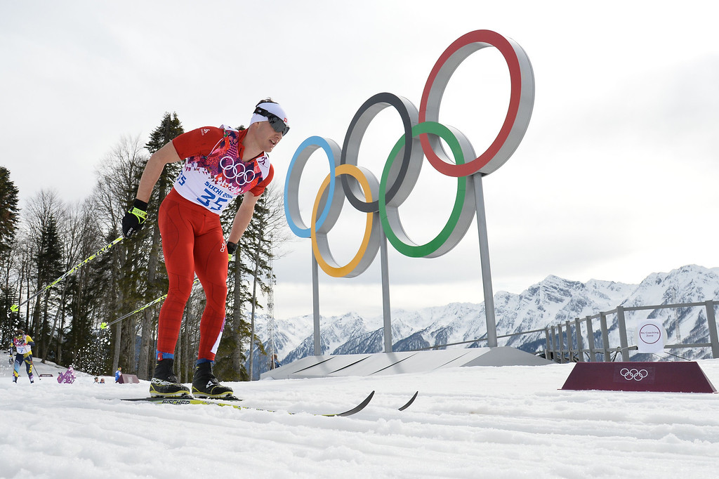 . Switzerland\'s Dario Cologna competes to win gold in the Men\'s Cross-Country Skiing 15km Classic at the Laura Cross-Country Ski and Biathlon Center during the Sochi Winter Olympics on February 14, 2014 in Rosa Khutor near Sochi.  AFP PHOTO / ALBERTO  PIZZOLI/AFP/Getty Images