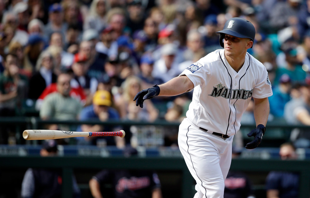 . Seattle Mariners\' Kyle Seager tosses aside his bat after walking against the Cleveland Indians in a baseball game Saturday, Sept. 23, 2017, in Seattle. (AP Photo/Elaine Thompson)