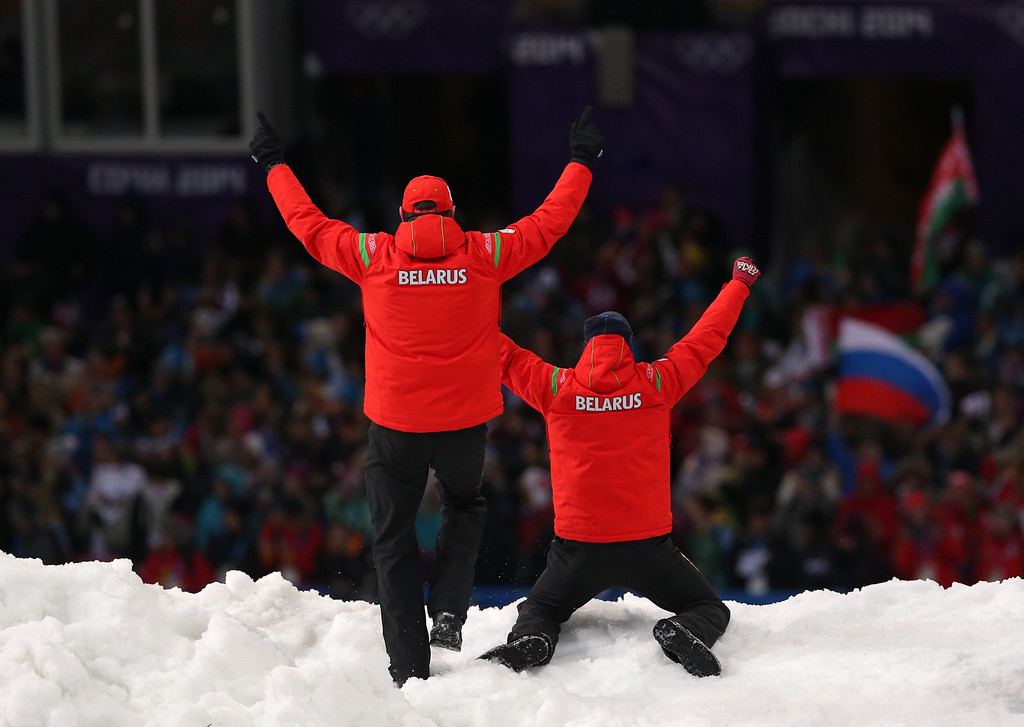 . Coaches celebrate after Anton Kushnir of Belarus won the men\'s freestyle skiing aerials final at the Rosa Khutor Extreme Park, at the 2014 Winter Olympics, Monday, Feb. 17, 2014, in Krasnaya Polyana, Russia. (AP Photo/Sergei Grits)