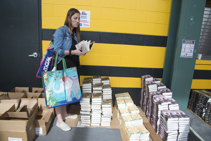 09/04/19  Wesley Bunnell | Staff  Twenty two thousand books were donated to area educators and parents with children by ESPN and Disney on Thursday September 4, 2019 at New Britain Stadium. Jen Zaffetti from Pathways Academy of Technology & Design chooses books for her students.