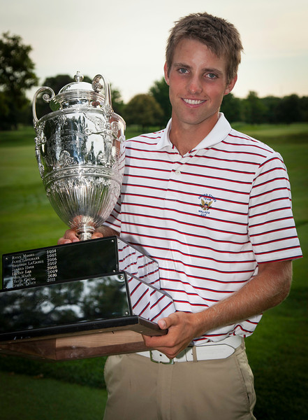 Chris Williams holds George R. Thorne trophy after winning the 2012 Western Amateur Championship at Exmoor Country Club in Highland Park IL. on Saturday, August 4, 2012. (WGA Photo/Charles Cherney)