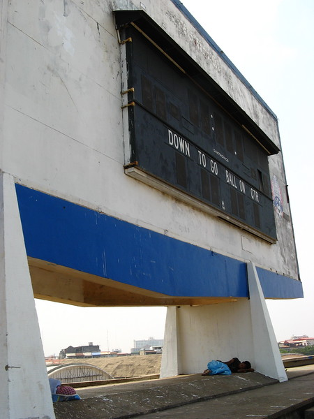 Cathing some zzzss under the scoreboard at the main stadium.