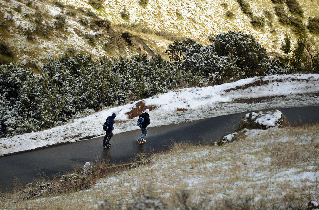 . With the road closed, two hikers make their way by foot up the road in Mount Diablo State Park where a dusting of snow turned the park into a winter wonderland in Walnut Creek, Calif., on Tuesday, Feb. 19, 2013.   (Susan Tripp Pollard/Staff)