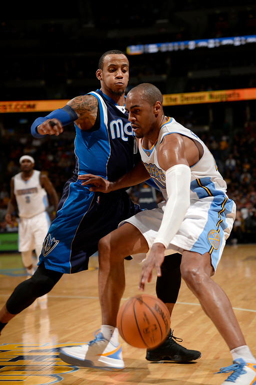. DENVER, CO - JANUARY 14: Dallas Mavericks guard Monta Ellis (11) puts pressure on Denver Nuggets guard Arron Afflalo (10) in the corner during the second quarter January 14, 2015 at Pepsi Center. (Photo By John Leyba/The Denver Post)