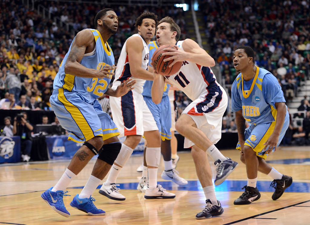 . SALT LAKE CITY, UT - MARCH 21:  David Stockton #11 of the Gonzaga Bulldogs drives to the basket against Brandon Moore #32 of the Southern University Jaguars in the first half during the second round of the 2013 NCAA Men\'s Basketball Tournament at EnergySolutions Arena on March 21, 2013 in Salt Lake City, Utah.  (Photo by Harry How/Getty Images)