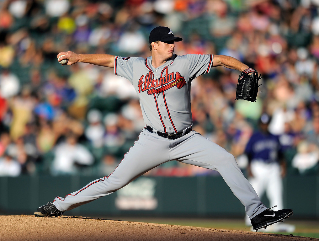 . Atlanta Braves starting pitcher Gavin Floyd throws in the first inning of a baseball game against the Colorado Rockies on Monday, June 9, 2014, in Denver. (AP Photo/Chris Schneider)