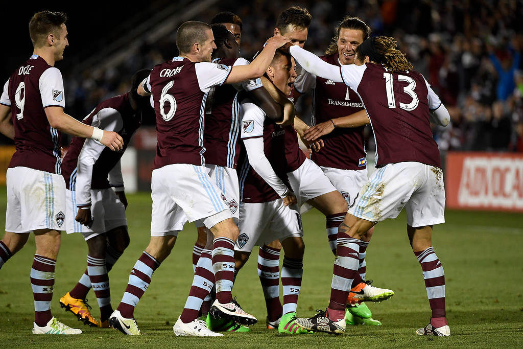 . COMMERCE CITY, CO - MAY 11: Teammates mob Dillon Serna (17) of Colorado Rapids after his game-winning goal against Sporting Kansas City during the second half of the Rapids\' 1-0 win. The Colorado Rapids hosted Sporting Kansas City on Wednesday, May 11, 2016. (Photo by AAron Ontiveroz/The Denver Post)