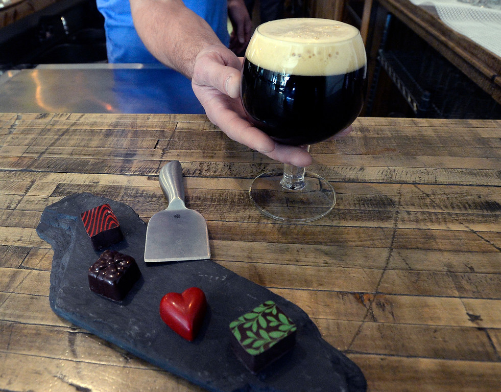 . LOUISVILLE, CO - November 14, 2018: A Belgian Quad with  chocolate caramel and raspberry heart truffles.  (Photo by Cliff Grassmick/Staff Photographer)