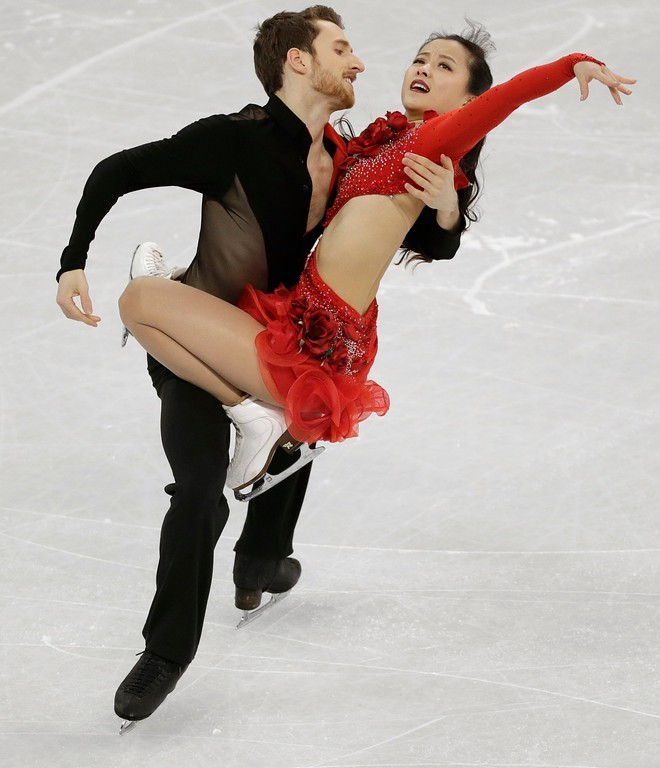 . FILE - In this Sunday Feb. 11, 2018, file photo, Yura Min and Alexander Gamelin of South Korea perform during the ice dance short dance team event in the Gangneung Ice Arena at the 2018 Winter Olympics in Gangneung, South Korea. Some three dozen skaters in the Pyeongchang Games are performing for nations in which they were not born. (AP Photo/David J. Phillip, File)