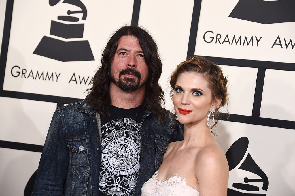. Dave Grohl, left, and Jordyn Blum arrive at the 57th annual Grammy Awards at the Staples Center on Sunday, Feb. 8, 2015, in Los Angeles. (Photo by Jordan Strauss/Invision/AP)