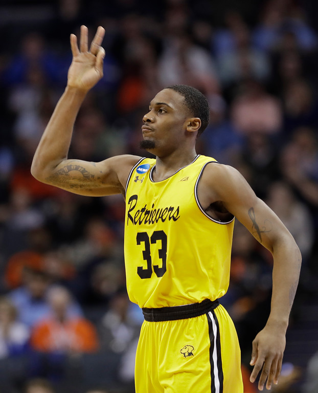 . UMBC\'s Arkel Lamar (33) reacts to making a basket against Virginia during the first half of a first-round game in the NCAA men\'s college basketball tournament in Charlotte, N.C., Friday, March 16, 2018. (AP Photo/Gerry Broome)