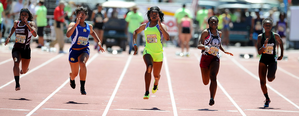 . Arianna Washington, center, of Long Beach Poly wins the 100 meter dash invitational high school as Claremont\'s Brittany Brown finished second during the Mt. SAC Relays in Hilmer Lodge Stadium on the campus of Mt. San Antonio College on Saturday, April 20, 2012 in Walnut, Calif.    (Keith Birmingham/Pasadena Star-News)