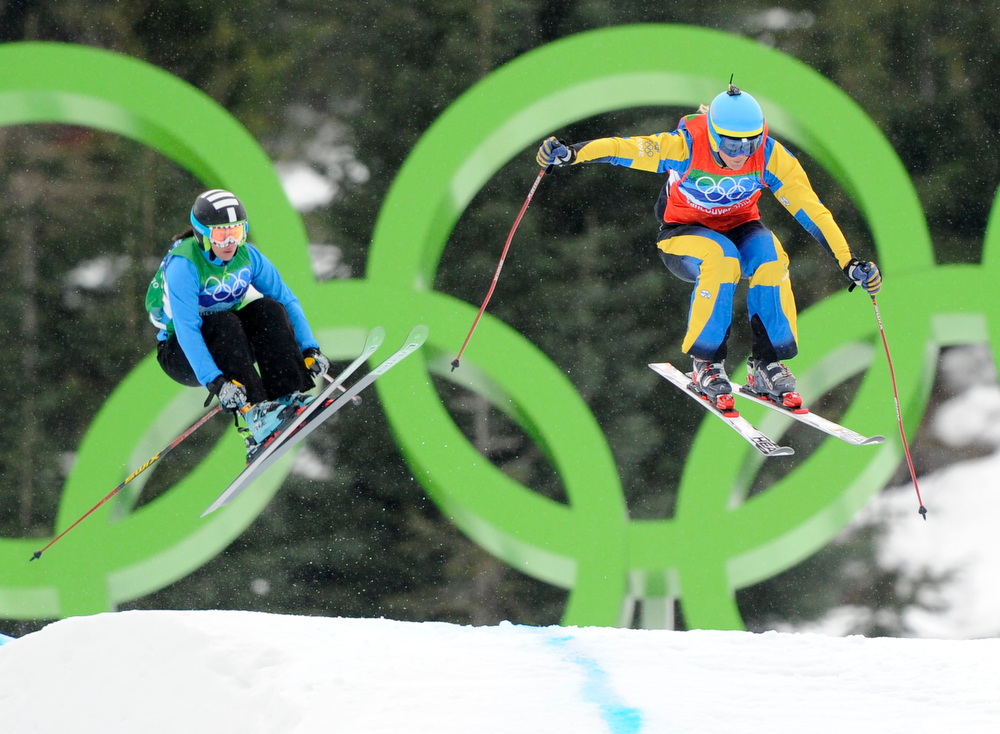 . Anna Holmlund of Sweden, right and Sasa Faric of Slovenia compete in the women\'s skicross 8th final at the Vancouver 2010 Olympics in Vancouver, British Columbia, Monday, Feb. 22, 2010. (AP Photo/Mark J. Terrill)