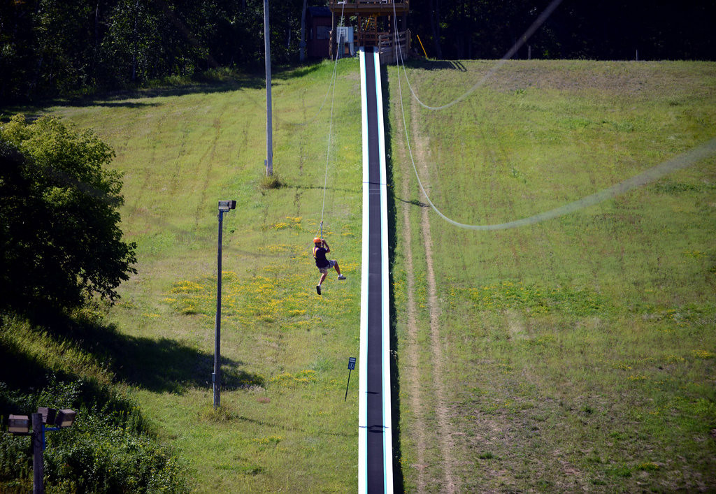 . A guest rides a zip line over the conveyor belt that transports customers part-way up the tubing hill at the Aerial Adventure Park at Trollhaugen.   (Pioneer Press: Chris Polydoroff)