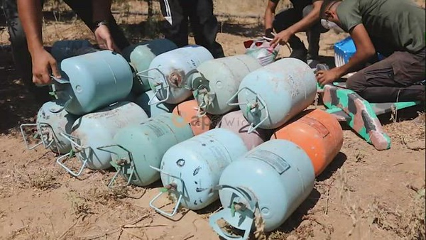 Masked Palestinians prepare incendiary balloons