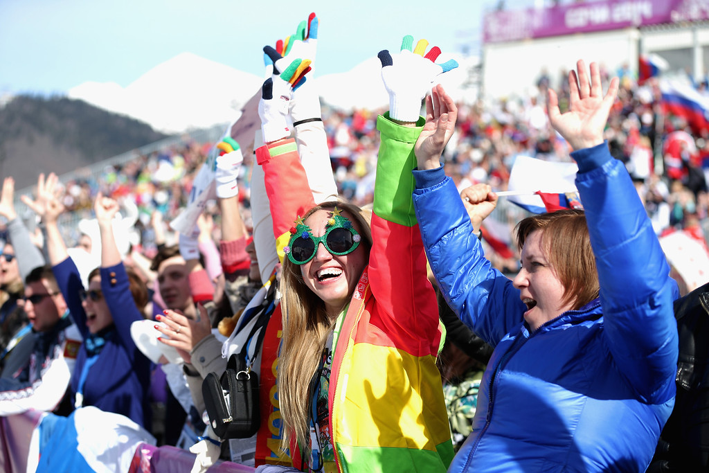 . SOCHI, RUSSIA - FEBRUARY 22: Fans cheer during the Snowboard Ladies\' Parallel Slalom 1/8 Final on day15 of the Sochi 2014 Winter Olympics at Rosa Khutor Extreme Park on February 22, 2014 in Sochi, Russia.  (Photo by Robert Cianflone/Getty Images)