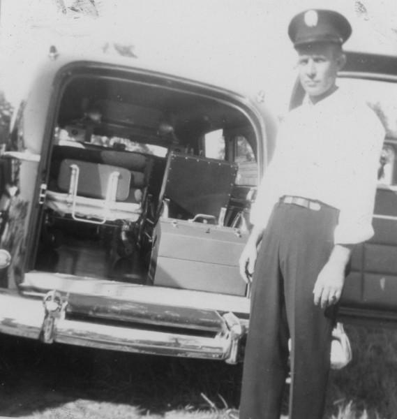Archie Tolbert back of ambulance
