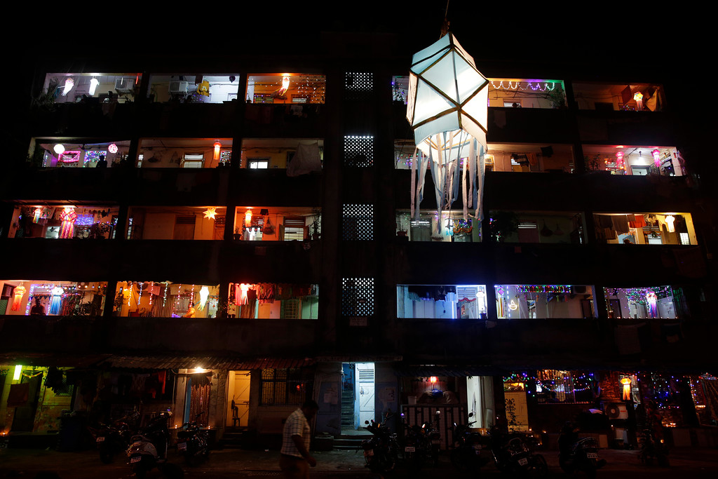 . A tenement block housing mostly fishermen families is illuminated with lights during Diwali in Mumbai India, Thursday, Oct. 19, 2017. Diwali, the Hindu festival of lights, is being celebrated across the country Thursday. (AP Photo/Rafiq Maqbool)