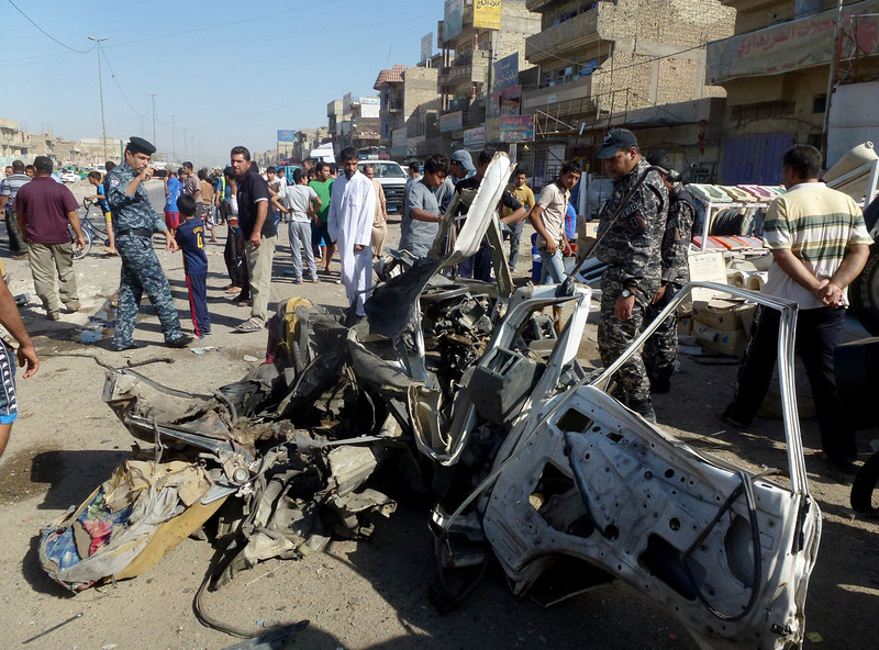 . Iraqis citizens and security forces inspect the site of a car bomb explosion in the impoverished district of Sadr City in Baghdad on July 29, 2013, after 11 car bombs hit nine different areas of Baghdad, seven of them Shiite-majority, while another exploded in Mahmudiyah to the south of the capital.  More than 3,000 people have been killed in violence since the beginning of the year, according to AFP figures based on security and medical sources -- a surge in unrest that the Iraqi government has so far failed to stem.  AHMAD AL-RUBAYE/AFP/Getty Images