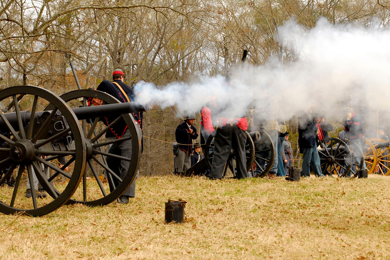 Union artillery reenactors fire the Parrot Rifle across the battlefield. The Skirmish at Gamble's Hotel happened on March 5, 1885 when 500 federal soldiers, under the command of Reuben Williams of the 12th Indiana Infantry, marched into Florence to destroy the railroad depot but were met by Confederate soldiers backed up with 400 militia. The reenactment, held by the 23rd South Carolina Infantry, was held at the Rankin Plantation in Florence, South Carolina on Saturday, March 5, 2011. Photo Copyright 2011 Jason Barnette