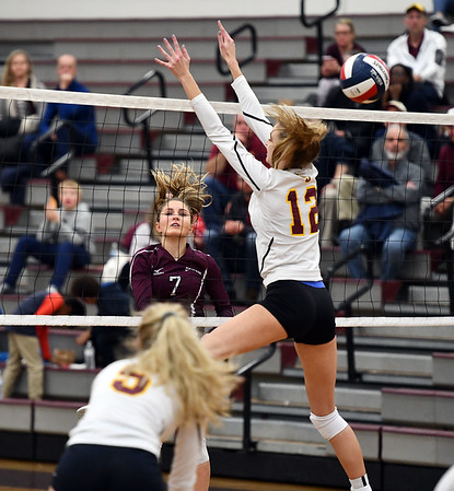 11/14/2019 Mike Orazzi | StaffrBristol Central High School's Peyton Greger (7) and St. Joseph High School's Ava Tuccio (12) during the Class L Second Round Girls Volleyball Tournament at Bristol Central Thursday night. r