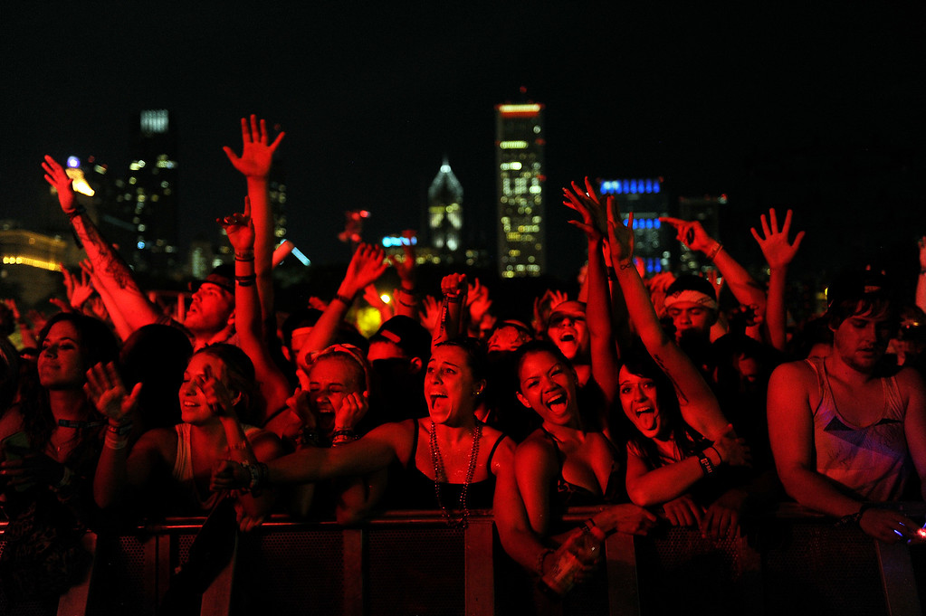 . Fans cheer as Knife Party performs during Lollapalooza at Grant Park on August 4, 2013 in Chicago, Illinois. (Photo by Seth McConnell/The Denver Post)