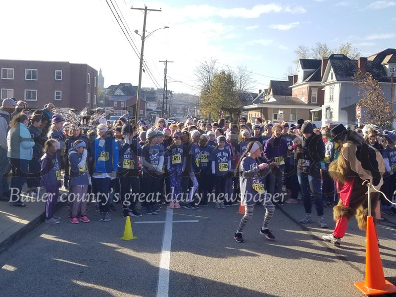 The 38th annual Butler YMCA Turkey Trot was Saturday. Runners flocked together to complete the frosty trek from the YMCA on North Washington street down East Pearl Street and looping through Butler Memorial Park before heading back to the YMCA.Jim Smith/Butler Eagle. 3 col pic